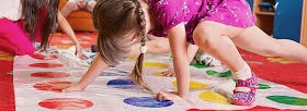 Image of a child on a Twister mat.